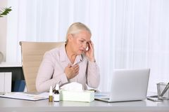 Ill mature woman suffering from cough royalty free stock photos