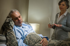 Ill old male patient and caring wife Stock Image