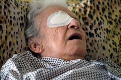 Ill person with eye bandage Stock Photo
