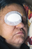 Ill person with eye bandage Royalty Free Stock Images