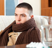Ill sad man in warm scarf Royalty Free Stock Photography