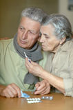 Ill senior couple with pills Royalty Free Stock Images