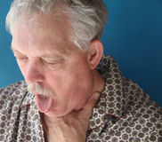 Ill senior man coughing Stock Image