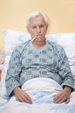 Ill senior man with thermometer Royalty Free Stock Photo