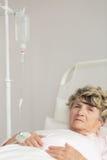 Ill senior woman Stock Photo