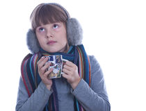 Ill teen girl. Girl in warm scarf with headphones and takes a spoonful of tasteless medicine isolated white portrait Royalty Free Stock Images