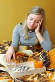 Ill woman. Is sitting on bed Royalty Free Stock Images