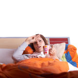 Ill woman in bed Stock Images