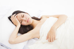 Ill woman in bed Royalty Free Stock Photography