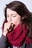 Ill woman. Close-up of young ill woman with cough Stock Photos