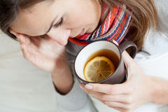 Ill woman drinking tea Royalty Free Stock Photos