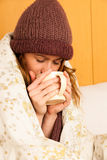 Ill woman with feaver drinking cup of warm tea Stock Image