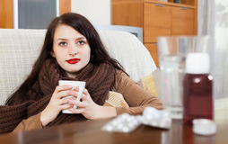 Ill  woman with medications Stock Image