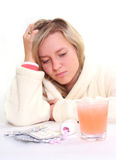 Ill woman and pills. Ill woman, water and pills Royalty Free Stock Photos