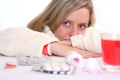 Ill woman and pills Stock Image