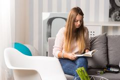 Ill woman reading about diabetes stock photography