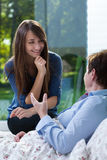 Ill woman talking with her daughter Stock Photography