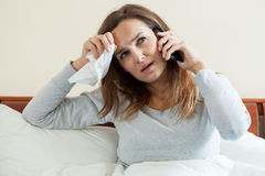 Ill woman talking on the phone Royalty Free Stock Photo
