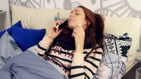 Ill woman talks about sick on phone and coughing stock video footage