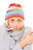 Ill woman with thermometer in her mouth Stock Photos