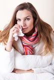 Ill woman with tissue Stock Image