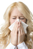 Ill woman with tissue is sneezing Stock Images
