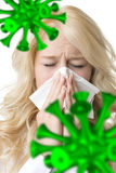 Ill woman with tissue is sneezing virus. Portrait of a ill blond woman who is sneezing bacillus in a virus stock photo