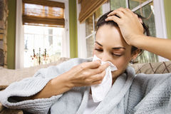 Ill Young Woman Blowing Nose Stock Photos