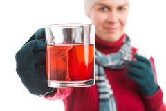 Ill young woman holding a cup of hot tea Stock Photography