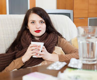 Ill young woman with medications Royalty Free Stock Photos
