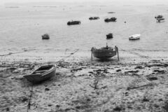 Small fishing boats, beached on the beach.