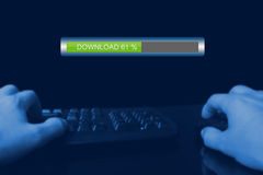 Illegal download internet. Internet download, hands on keyboard Royalty Free Stock Photos