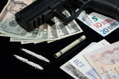 Illegal drugs , money and guns Stock Photos