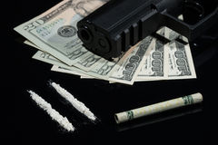 Illegal drugs , money and guns Stock Photography