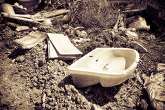 Illegal dumping. Education and rudeness concept - toned image Stock Images