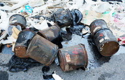 Illegal dumping of hazardous waste. Hazardous waste on road side stock photo
