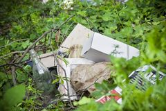 Illegal dumping in nature. Illegal dumping: education and rudeness concept Royalty Free Stock Image