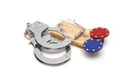 Illegal Gambing Trap. Items to illustrate illegal gambling temptation Royalty Free Stock Images