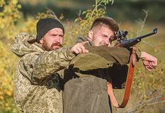 Illegal hunting. Hunters brutal poachers. Forbidden hunting. Breaking law. Poaching concept. Activity for brutal men. Hunters poachers looking for victim royalty free stock photo