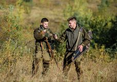 Illegal hunting. Hunters friends enjoy leisure. Poacher partner in crime. Activity for real men concept. Hunters. Gamekeepers looking for animal or bird royalty free stock image