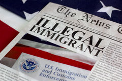 Illegal immigrant headline. Illegal immigrant on the news paper headline Stock Photography