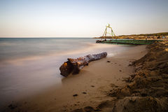 Illegal immigration. A driftwood indicating an abandoned boat of illegal immigrants by now covered by the sand royalty free stock photography