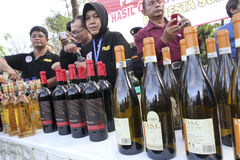 Illegal liquor. Police seized illegal liquor during a raid in the city of Solo, Central Java, Indonesia Stock Image