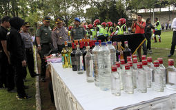 Illegal liquor. Police seized illegal liquor during a raid in the city of Solo, Central Java, Indonesia Stock Photography