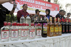 Illegal liquor. Police seized illegal liquor during a raid in the city of Solo, Central Java, Indonesia Royalty Free Stock Image