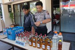 Illegal liquor. Police seized illegal liquor in a raid to suppress crime in the city of Solo, Central Java, Indonesia Royalty Free Stock Photo