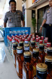 Illegal liquor. Police seized illegal liquor in a raid to suppress crime in the city of Solo, Central Java, Indonesia Royalty Free Stock Images