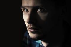 Illegal man. Illagal man in the dark prison. Close-up portrait Stock Images