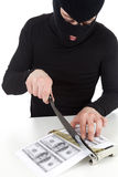 Illegal manufactory of money. Falsifier cutting banknotes on guillotine, white background Royalty Free Stock Photography