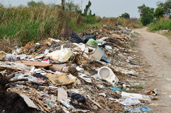 Illegal Roadside Dumping. In the forest stock images